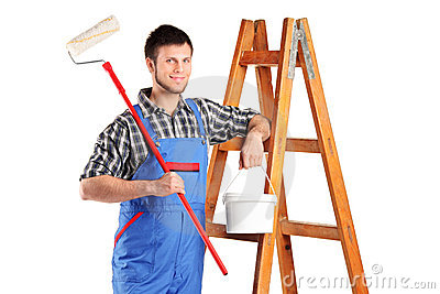 Worker standing next to a ladder