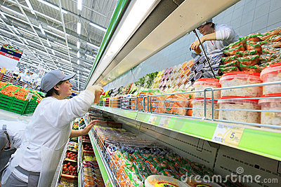 Worker in supermarket Editorial Photography