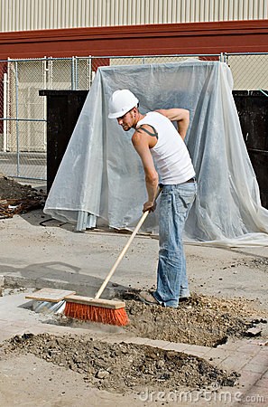 Free Worker Sweeping Dirt Stock Images - 7418624