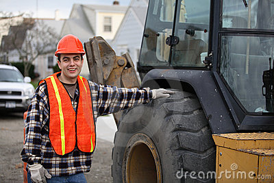 Worker by tractor