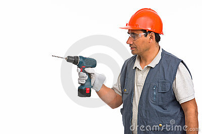 Worker using cordless electric drill