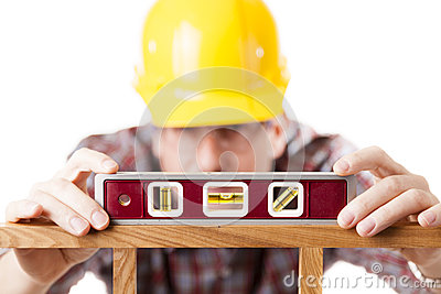 Worker using level