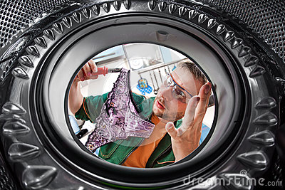 Worker and a washing machine