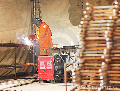 Worker weld metal gratings by acetylene torch Stock Photo