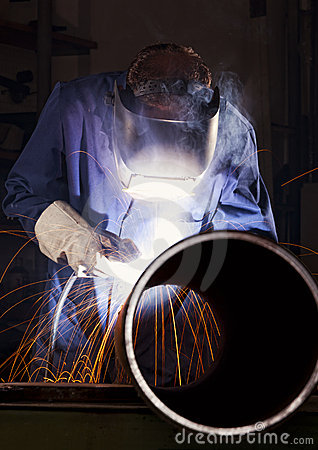 Free Worker Welding Pipe In Workshop. Stock Photos - 19807213