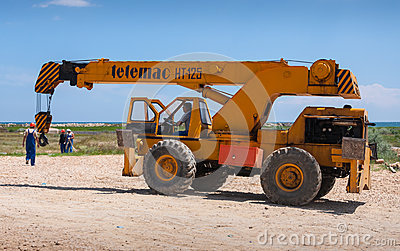 Workers auto crane construction site Editorial Stock Photo