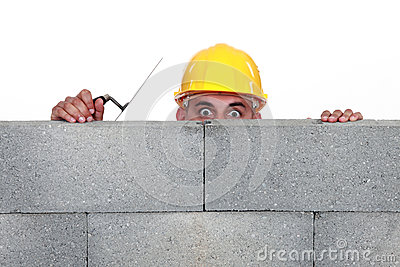 Workers behind wall