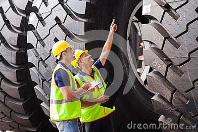 Workers checking tires