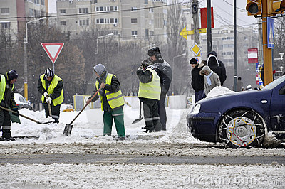 Workers cleaning city after blizzard Editorial Photo