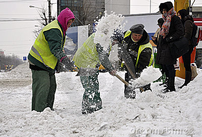 Workers cleaning city snow Editorial Photo