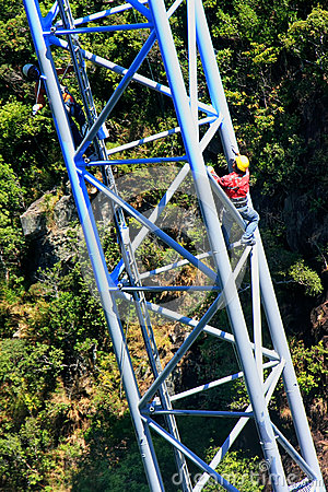 Free Workers Climing Supporting Pole, Sky Bridge Royalty Free Stock Photos - 39036718