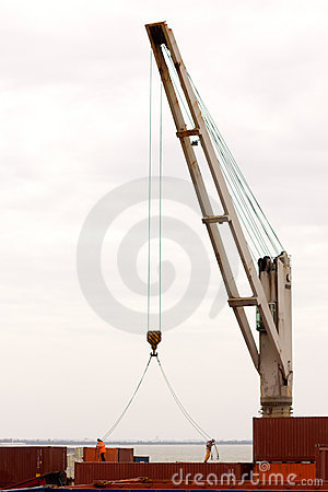 Workers, crane, containers in sea port