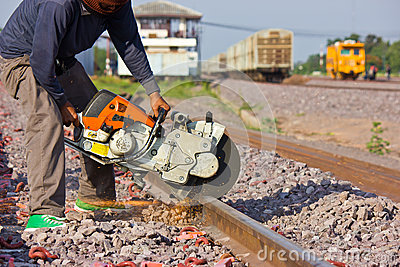 Workers  cutting tracks for maintenance.