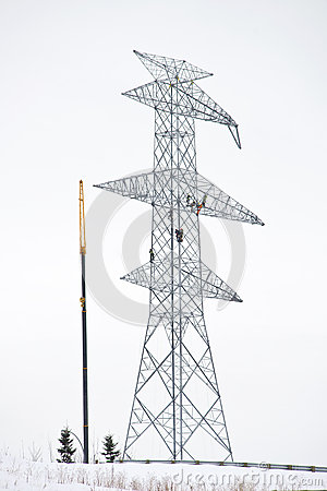 Workers on Electrical Tower