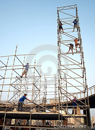Workers Erect a Stage Editorial Photo