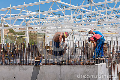 Workers on construction site Editorial Stock Photo