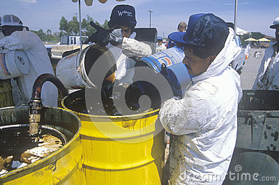 Workers handling toxic household wastes Editorial Photography