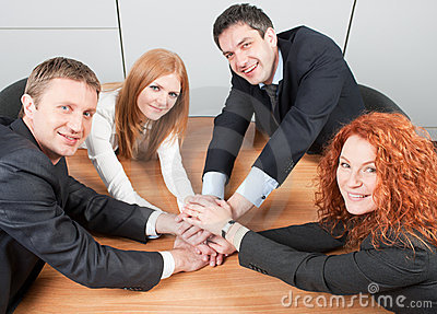Workers hold hands together
