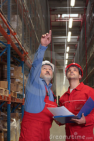 Free Workers In Warehouse Stock Image - 5562651