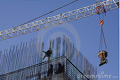 Workers install armature