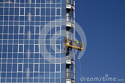 Workers installing glass window