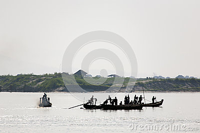 Workers on the Irrawaddy River Editorial Photo