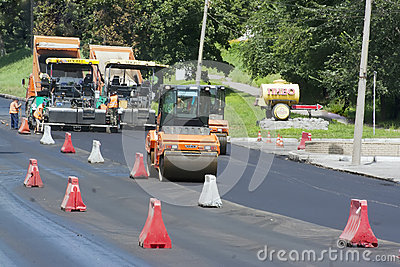 Workers laid asphalt on road