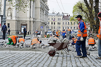 Workers laid paving stones Editorial Stock Image