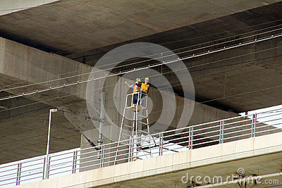 Workers overhaul wire line Editorial Photo