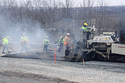 Workers paving a road Editorial Photography