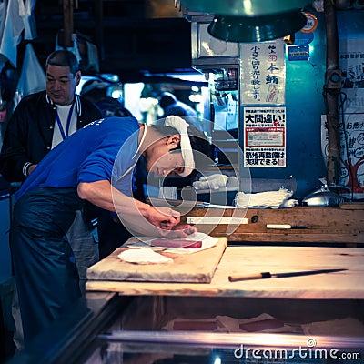 Free Workers Processing Tuna At Tsukiji Market In Japan Royalty Free Stock Photography - 26743567