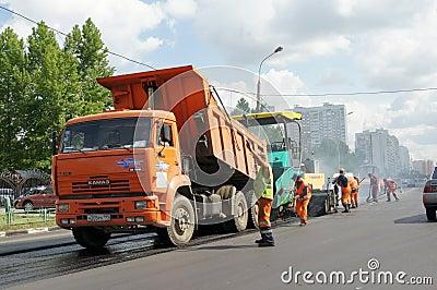 Workers repairs road Editorial Stock Photo