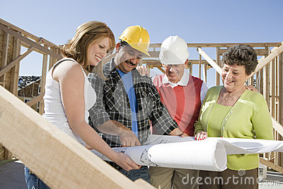 Workers Reviewing Blueprint
