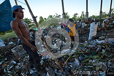 Workers in a scavenging at the dump Editorial Photo