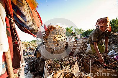 Workers in a scavenging at the dump Editorial Image