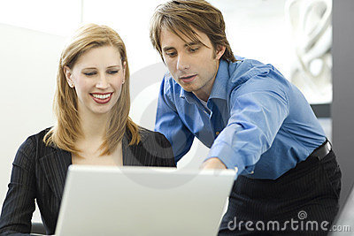 Workers share a computer