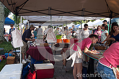 Workers and Shoppers at Outdoor Farmer�s Market Editorial Photography