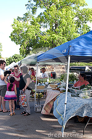 Workers and Shoppers at Outdoor Farmer�s Market Editorial Stock Image