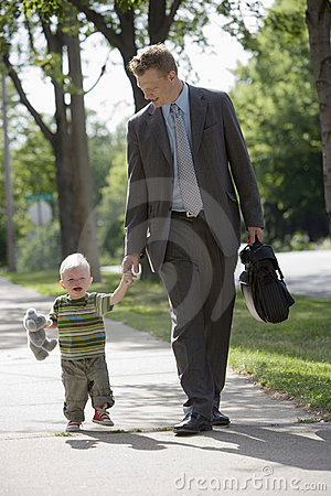 Working Dad walking with his son