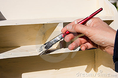 Working Hands Painting Shelves in Sunshine