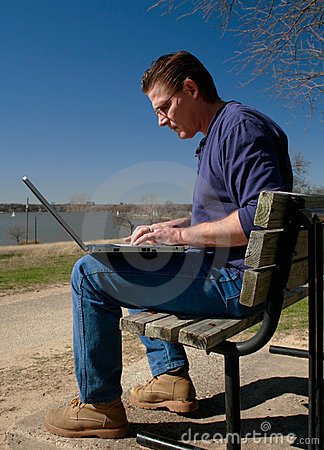 Working on Laptop in Park