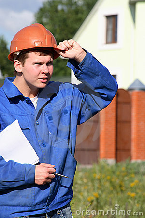 A working man with a plan of construction