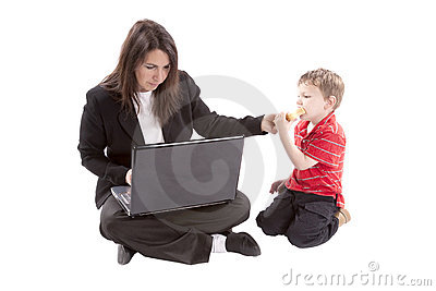 Working mom giving son sandwich