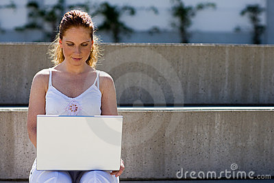 Working outdoor with laptop