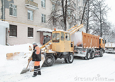 Working people clean the snow on street Editorial Stock Photo