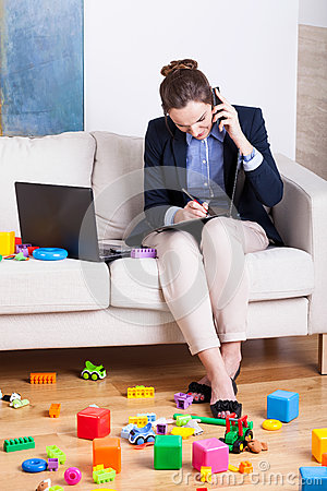 Working woman among child s toys