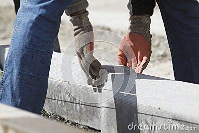 Workman aligning bricks