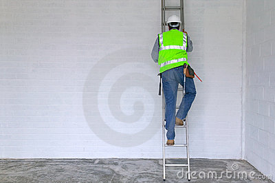 Workman climbing a ladder