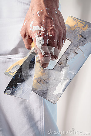 Free Workman Hand Holding Putty Knife With Plaster Royalty Free Stock Photos - 66550938