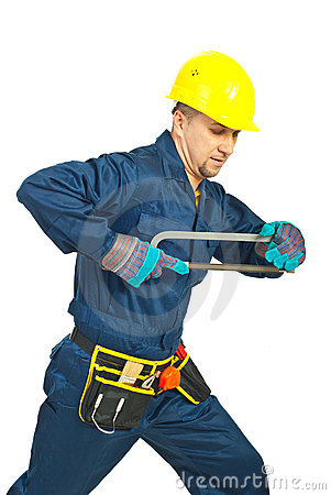 Workman holding saw
